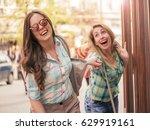 two beautiful smiling women...   Shutterstock . vector #629919161