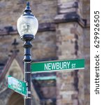 Street sign in Boston, Massachusetts, USA at the corner of the Famous Newbury Street and Berkeley Street on a sunny day.