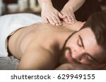 man at beautician's getting an... | Shutterstock . vector #629949155