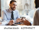 confident employer talking to... | Shutterstock . vector #629949677