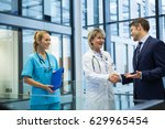 female doctor shaking hands... | Shutterstock . vector #629965454