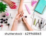 nail care. closeup of female... | Shutterstock . vector #629968865