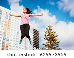 the girl jumps because her... | Shutterstock . vector #629973959