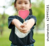 asian little girl showing...   Shutterstock . vector #629995181