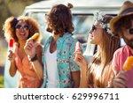 group of friends enjoying and... | Shutterstock . vector #629996711