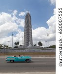 Small photo of HAVANA, CUBA - APR 17, 2017: Jose Marti Memorial at Revolution Square, Havana, Cuba with blurry green classic car passing. Jose Marti Memorial is a memorial to Jose Marti, a national hero of Cuba.
