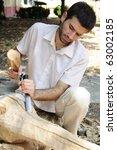 Young Man Sculpting Wood...