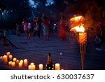 night lit torch on the beach...   Shutterstock . vector #630037637