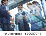 business executives using... | Shutterstock . vector #630057749