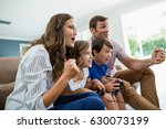 excited family playing video... | Shutterstock . vector #630073199