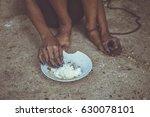 closeup children hand eating on ... | Shutterstock . vector #630078101