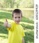 boy giving a thumbs up | Shutterstock . vector #630129929