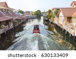 the long tail boat cruising... | Shutterstock . vector #630133409