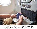 man in airplane with passport...   Shutterstock . vector #630167855
