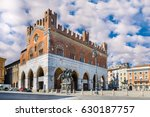 Piacenza, Italy. Piazza Cavalli (Square horses) and palazzo Gotico (Gothic palace) in the city center. Main square of Piacenza on a beautiful day with blue sky and white clouds