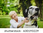 woman playing with her pet  ... | Shutterstock . vector #630193229