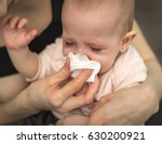 a small  sick  crying child ... | Shutterstock . vector #630200921