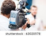 cameraman at work. shallow dof... | Shutterstock . vector #63020578