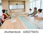 business team looking at white... | Shutterstock . vector #630275651