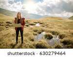 Young Woman Traveler With A...