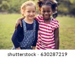 little girls hugging together... | Shutterstock . vector #630287219