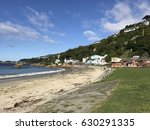 beach and houses facing mana... | Shutterstock . vector #630291335