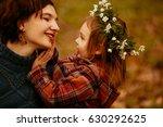 the daughter embracing her... | Shutterstock . vector #630292625