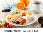breakfast with boiled egg  ham... | Shutterstock . vector #630311165