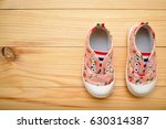 children's shoes on a wooden... | Shutterstock . vector #630314387