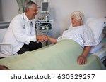 doctor examining senior patient ...   Shutterstock . vector #630329297