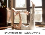 young yogi smiling mother doing ... | Shutterstock . vector #630329441