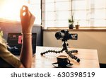 female vlogger looking at... | Shutterstock . vector #630398519