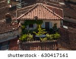 house on the roof. lucca. italy | Shutterstock . vector #630417161
