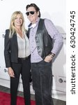 Small photo of New York, NY, USA - April 26, 2017: Actors DeAnna and Michael Madsen attend 25th Anniversary Retrospective Screening of Reservoir Dogs at The 2017 Tribeca Film Festival at Beacon Theatre, Manhattan