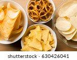 salty snacks. pretzels  chips ... | Shutterstock . vector #630426041