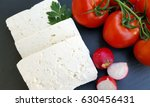 white cheese with tomatoes  | Shutterstock . vector #630456431
