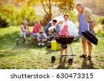 family grilling barbecue on... | Shutterstock . vector #630473315