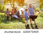 happy family camping and making ... | Shutterstock . vector #630473405