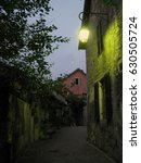 dark street of a village before ... | Shutterstock . vector #630505724