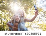 couple taking selfie while... | Shutterstock . vector #630505931
