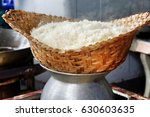 steaming sticky rice on earthen ... | Shutterstock . vector #630603635