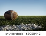 a worn football laying on a... | Shutterstock . vector #63060442
