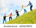 young people helping each other ... | Shutterstock . vector #630629891