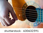 man hands playing acoustic... | Shutterstock . vector #630632591