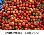 Large collection of tomatoes sold at large market in Fethiye, Turkey - stock photo