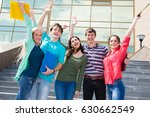 happy students jumping for joy... | Shutterstock . vector #630662549