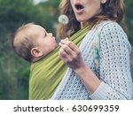 a young mother with a baby in a ... | Shutterstock . vector #630699359