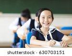 happy little girl in school... | Shutterstock . vector #630703151