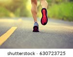 young fitness woman runner legs ... | Shutterstock . vector #630723725