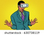 shocked african american in vr... | Shutterstock .eps vector #630738119